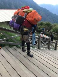 Mad badass Bunun porter testing if his pack is balanced.